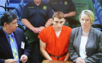 FORT LAUDERDALE, FL - FEBRUARY 15: Nikolas Cruz, 19, a former student at Marjory Stoneman Douglas High School in Parkland, Florida, where he allegedly killed 17 people, is seen on a closed circuit television screen during a bond hearing in front of Broward Judge Kim Mollica at the Broward County Courthouse.(Photo by Susan Stocker - Pool/Getty Images) thegrio.com