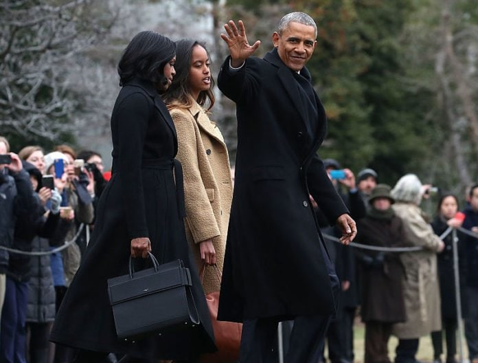WASHINGTON, DC - JANUARY 10: U.S. President Barack Obama waves as he walks with first lady Michelle Obama and daughter Malia, toward Marine One while departing from the White House, on January 10, 2017 in Washington, DC. President Obama is traveling to Chicago where he will deliver his farewell speech. (Photo by Mark Wilson/Getty Images) thegrio.com
