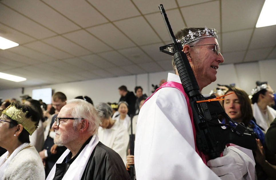 Rifle-toting couples blessed in weird church ceremony