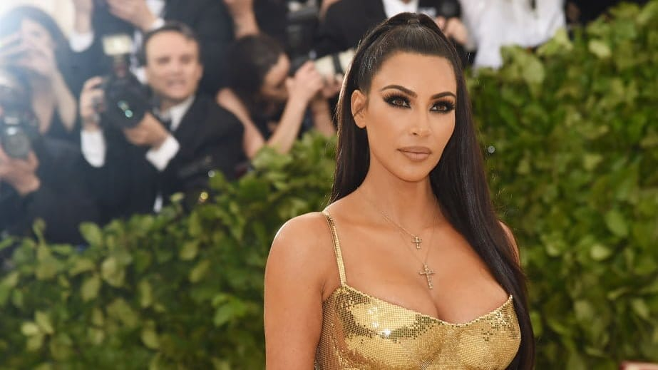 Kim Kardashian Slams Rapper for Accusing Kanye West of 'Abandoning' Chicago