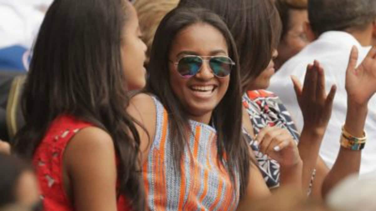 Obamas celebrate daughter Sasha's graduation, along with an extended family member