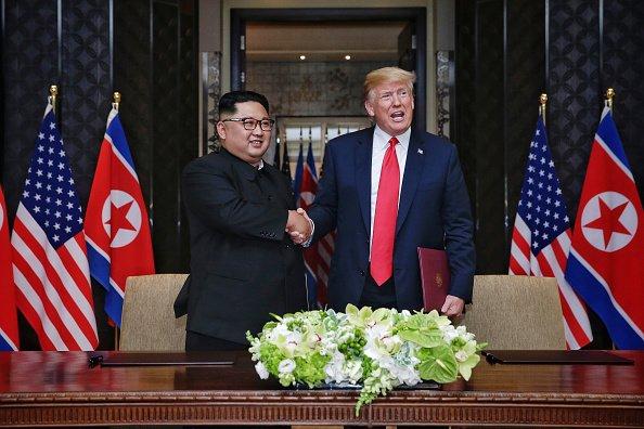 Donald Trump Kim Jong-un thegrio.com
