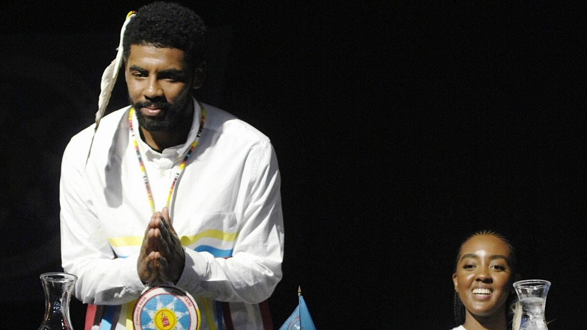 7574c283126 Boston Celtic point guard Kyrie Irving gestures his thanks to a group of  students from Little Eagle