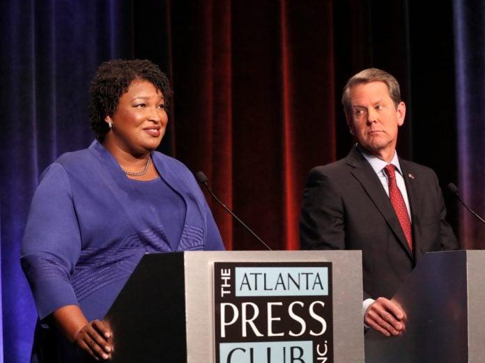 Stacey Abrams and Brian Kemp Georgia thegrio.com
