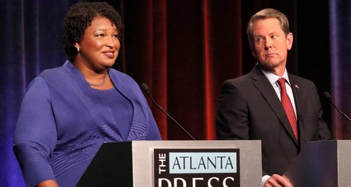 Stacey Abrams and Brian Kemp Georgia thegrio.com