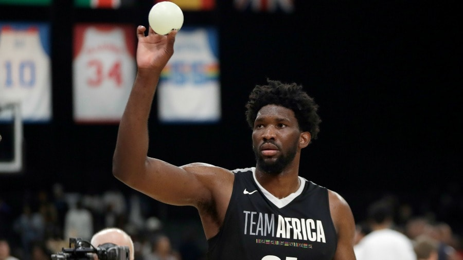 c94f205c9216 Team Africa s Joel Embiid throws balls to fans during the NBA Africa Game  between Team Africa and Team World
