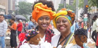 Black Consciousness Day Parade in São Paulo. She was just one-year-old when her grandmother brought her to her first parade. These days, dressed traditionally in headwraps and long skirts, she and her grandmother are seen at the annual event carryin thegrio.com
