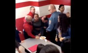 Video of a Black female Hazeltown Area High School student being brutally restrained by four security officers has gone viral. (Twitter)
