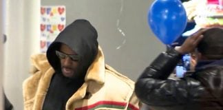 """In this image made from a video, R. Kelly stops at a McDonald's restaurant in Chicago Monday, Feb. 25, 2019, after a suburban Chicago woman posted the $100,000 bail for R. Kelly to be freed from jail while he awaits trial on sexual abuse charges. R. Kelly signed autographs and waved at a fan who yelled """"I love you!"""" when he stopped at McDonald's in downtown Chicago. (WFLD via AP) thegrio.com"""