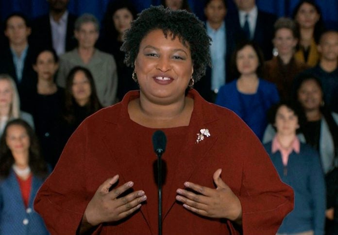 In this pool image from video, Stacey Abrams delivers the Democratic party's response to President Donald Trump's State of the Union address, Tuesday, Feb. 5, 2019 from Atlanta. Abrams narrowly lost her bid in November to become America's first black female governor, and party leaders are aggressively recruiting her to run for U.S. Senate from Georgia. Speaking from Atlanta, Abrams calls the shutdown a political stunt that