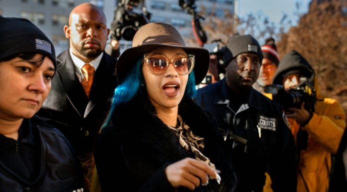 Rapper Cardi B, center, arrives at Queens County Criminal Court, Friday, Dec. 7, 2018, in New York. The platinum-selling hip hop star is scheduled to appear in court on charges related to a brawl at a New York strip club. (AP Photo/Andres Kudacki) thegrio.com