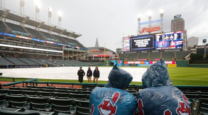 CLEVELAND, OH - JUNE 22: Cleveland Indians fans wait out a rain delay before the start of the game against the Detroit Tigers at Progressive Field on June 22, 2018 in Cleveland, Ohio. (Photo by David Maxwell/Getty Images)