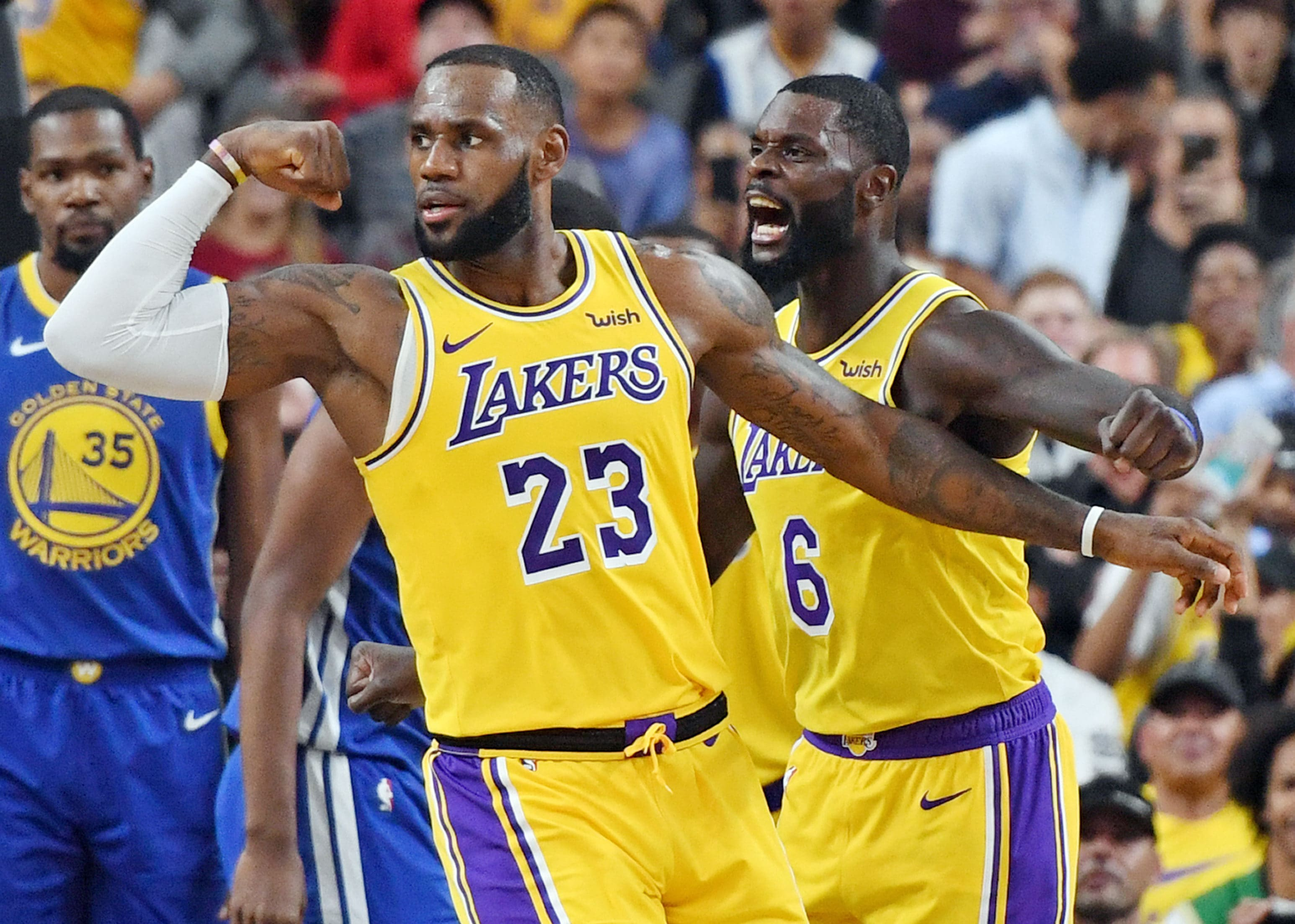 fc3fe31c817 LeBron James  23 and Lance Stephenson  6 of the Los Angeles Lakers  celebrate after James made a shot against the Golden State Warriors.
