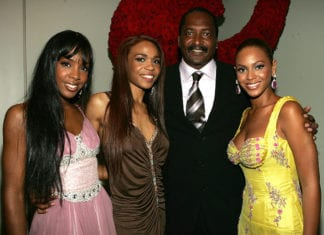 """Singers Kelly Rowland, Michelle Williams and Beyonce Knowles pose with their manager Matthew Knowles at the """"Beyonce: Beyond the Red Carpet auction presented by Beyonce and her mother Tina Knowles along with the House of Dereon to benefit the VH1 Save The Music Foundation June 23, 2005 in New York City. (Photo by Frank Micelotta/Getty Images) thegrio.com"""