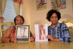 In this Wednesday, April 10, 2019, photo Mylinda Byrd Washington, 66, right, and Louvon Byrd Harris, 61, hold up photographs of their brother James Byrd Jr. in Houston. James Byrd Jr. was the victim of what is considered to be one of the most gruesome hate crime murders in recent Texas history. (AP Photo/Juan Lozano) thegrio.com