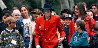 """In this April 18, 1995, file photo, pop star Michael Jackson and Lisa Marie Presley, behind him at left, walk with children that were invited guests at his Neverland Ranch home in Santa Ynez, Calif. The co-executor of Jackson's estate says he's confident the late superstar's supporters will be able to protect his legacy and brand in the wake of HBO's """"Leaving Neverland,"""" a documentary detailing allegations of sexual abuse. (AP Photo/Mark J. Terrill, File) thegrio.com"""