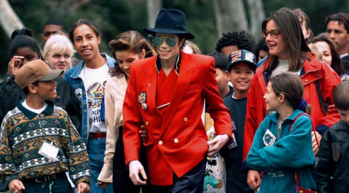 "In this April 18, 1995, file photo, pop star Michael Jackson and Lisa Marie Presley, behind him at left, walk with children that were invited guests at his Neverland Ranch home in Santa Ynez, Calif. The co-executor of Jackson's estate says he's confident the late superstar's supporters will be able to protect his legacy and brand in the wake of HBO's ""Leaving Neverland,"" a documentary detailing allegations of sexual abuse. (AP Photo/Mark J. Terrill, File) thegrio.com"