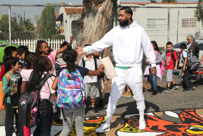LOS ANGELES, CA - OCTOBER 22: Nipsey Hussle greets kids at the Nipsey Hussle x PUMA Hoops Basketball Court Refurbishment Reveal Event on October 22, 2018 in Los Angeles, California. (Photo by Jerritt Clark/Getty Images for PUMA) thegrio.com