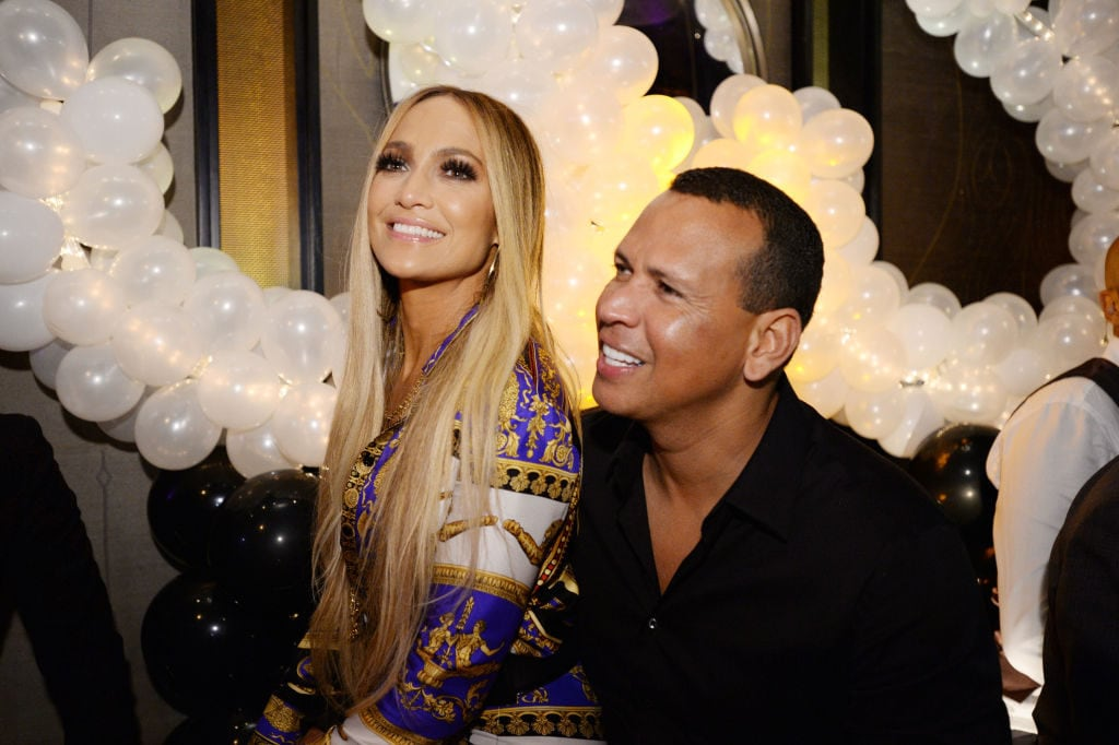Jennifer Lopez and Alex Rodriguez attend Jennifer Lopez's MTV VMA's Vanguard Award Celebration at Beauty & Essex on August 21, 2018 in New York City. (Photo by Andrew Toth/Getty Images for TAO Group) thegrio.com