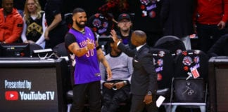 Rapper Drake is seen wearing a Dell Curry jersey before Game One of the 2019 NBA Finals between the Golden State Warriors and the Toronto Raptors at Scotiabank Arena on May 30, 2019 in Toronto, Canada. NOTE TO USER: User expressly acknowledges and agrees that, by downloading and or using this photograph, User is consenting to the terms and conditions of the Getty Images License Agreement. (Photo by Vaughn Ridley/Getty Images)