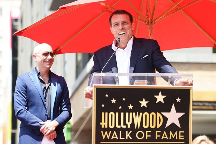 Pitbull (L) and Tony Robbins speak onstage as Pitbull is honored with a Star on The Hollywood Walk of Fame on July 15, 2016 in Hollywood, California. (Photo by Matt Winkelmeyer/Getty Images)