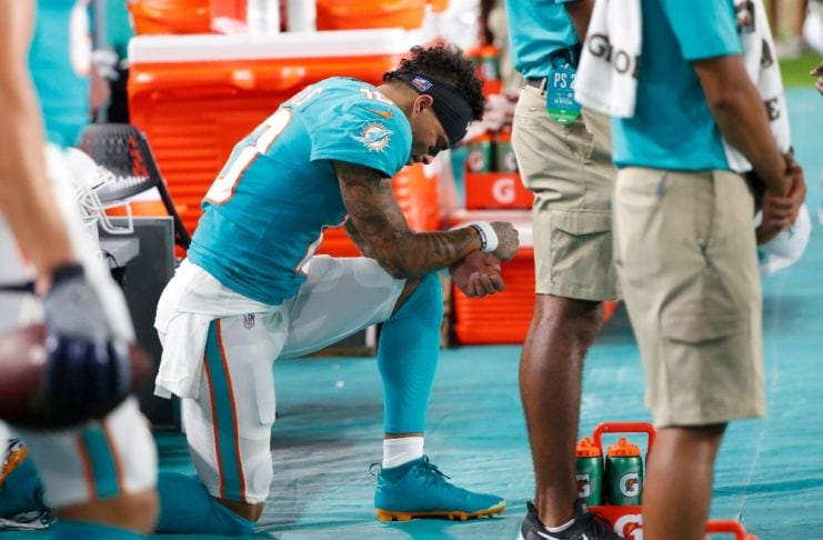 Miami Dolphins wide receiver Kenny Stills kneels during the singing of the National Anthem before the start of an NFL football preseason game against the Jacksonville Jaguars, Thursday, Aug. 22, 2019 in Miami Gardens, Fla. (AP Photo/Wilfredo Lee) thegrio.com