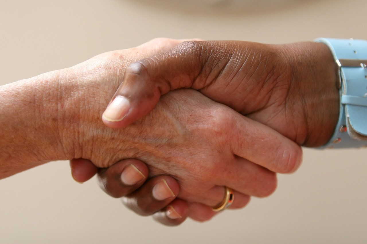 Shaking hands in business thegrio