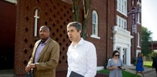 Presidential candidate Beto O'Rourke(right) and Rev. Robert L. Turner Sr. pass the the Vernon AME Church while on a tour of the Greenwood District Monday, Aug. 19, 2019. MIKE SIMONS/Tulsa World