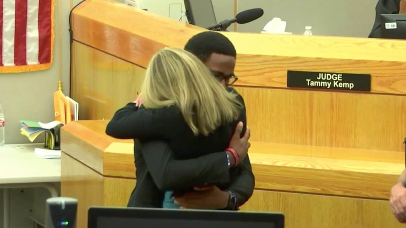 Judge's hug not embraced by all after Dallas officer's trial