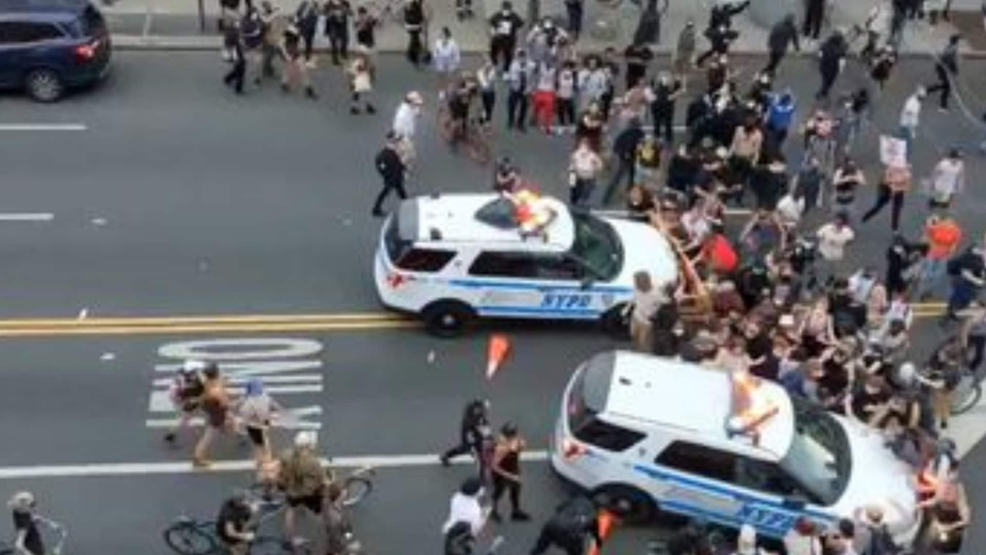 NYPD car plows into protesters, mayor says they should have 'gotten out of the way' - TheGrio