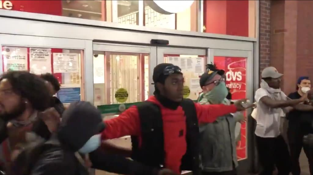 Brooklyn protesters form line to prevent looting of Target store