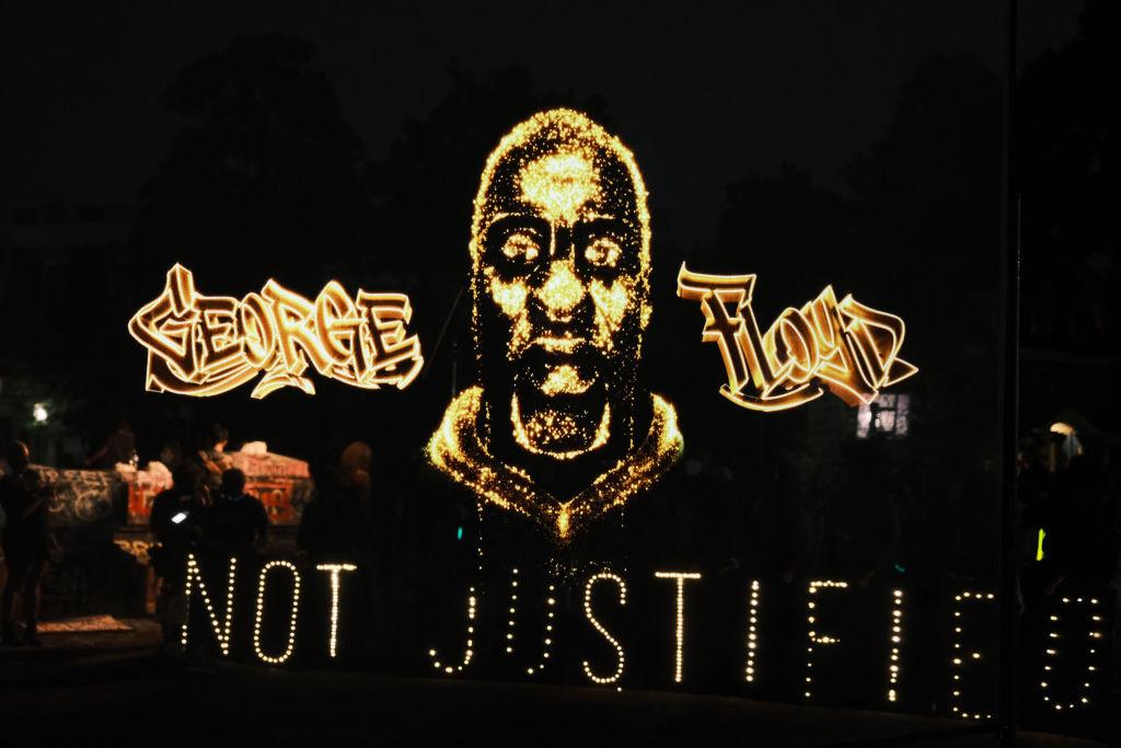 White woman uses N-word at George Floyd hologram tribute in Virginia - TheGrio