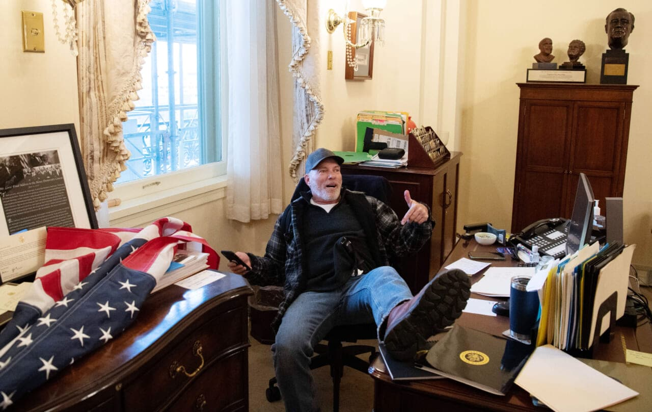 Man who posed at Pelosi's desk arrested, makes disturbing comments