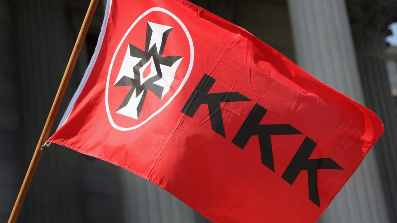 Neighbors hang KKK flag in window in response to Black neighbor's security camera - TheGrio