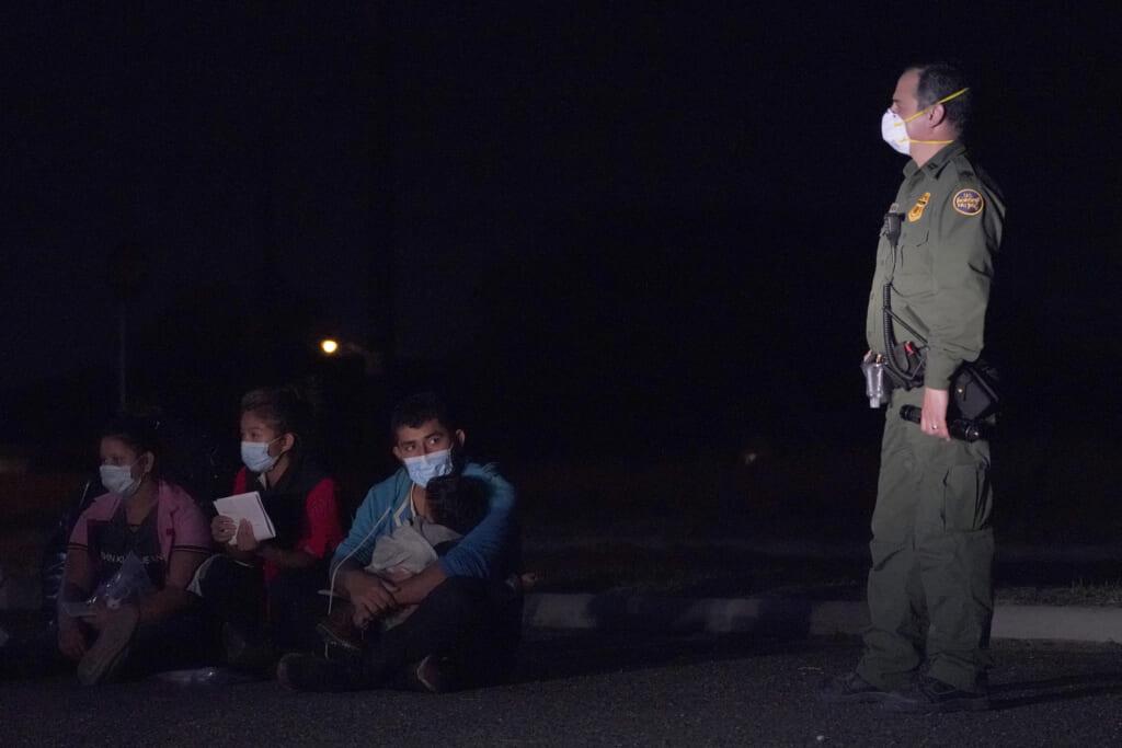 Migrant man holds child