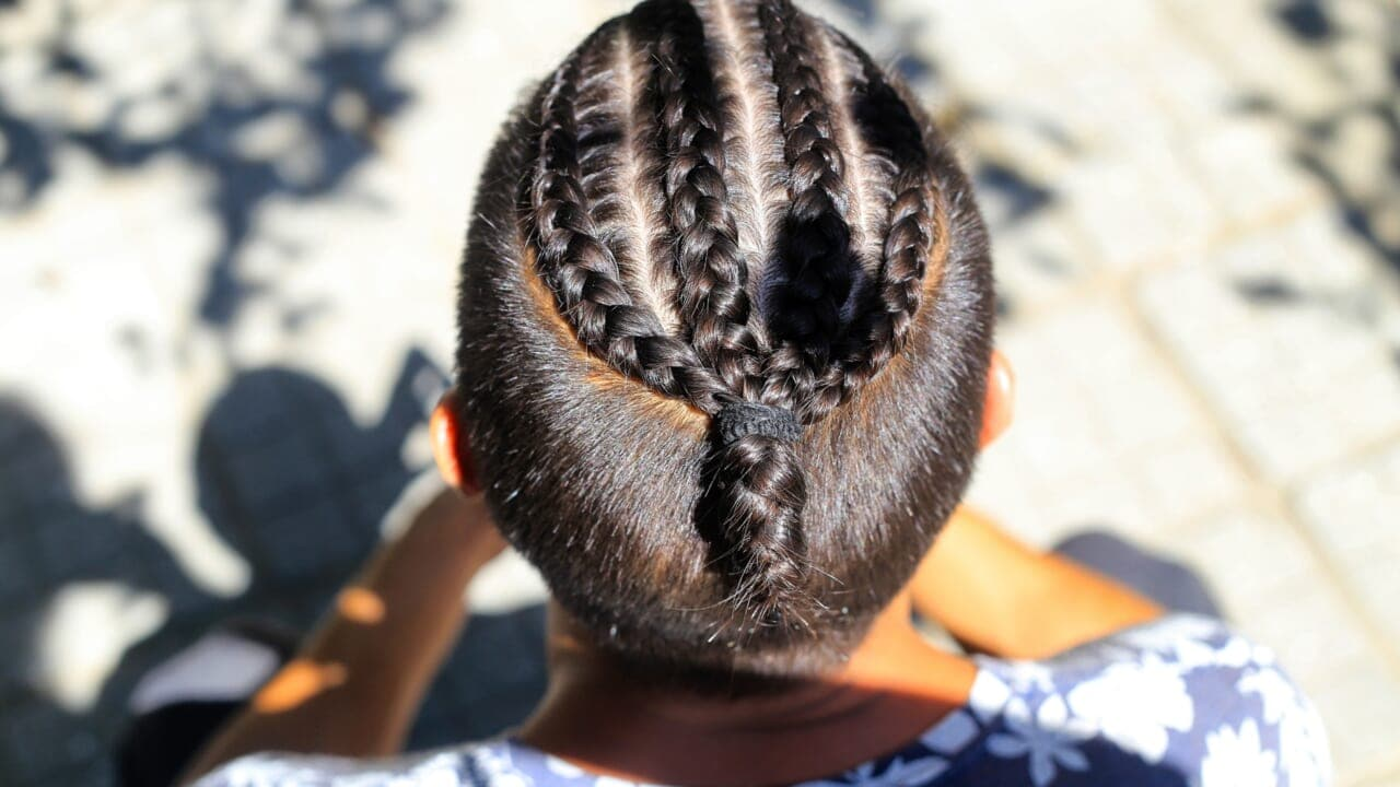 Backlash after Chicago school says four-year-old boy can't wear braids