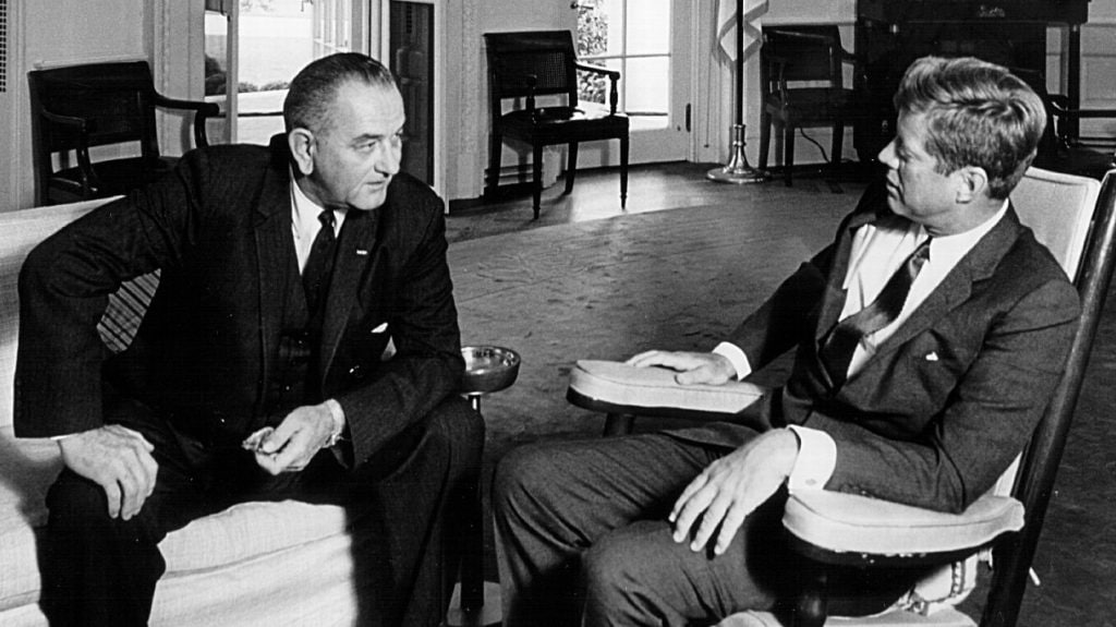 President John F. Kennedy, right, meets with Vice President Lyndon B. Johnson