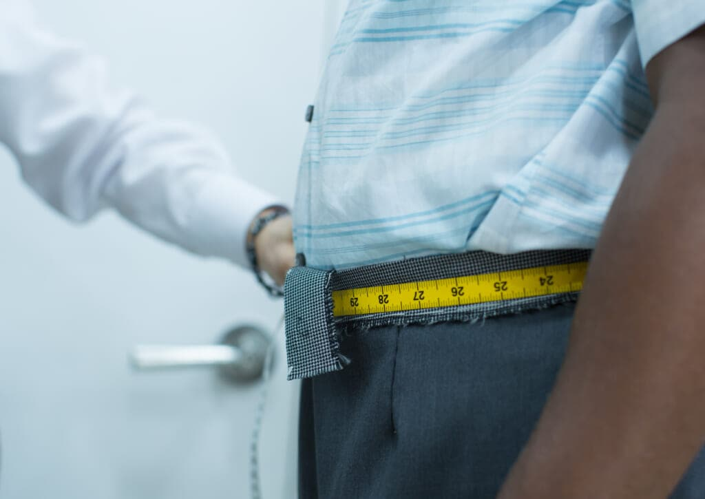 Black man has waist measured
