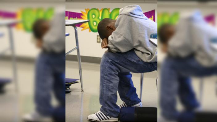 Black student sad in classroom x theGrio.com
