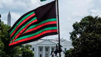 A Pan-African flag flies from Black Lives Matter Plaza overlooking the White House