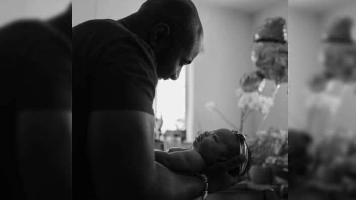 Karega Bailey holds his daughter Kamali Sade Sol Bailey