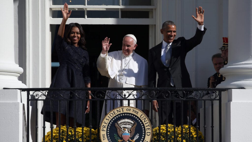 U.S. President Barack Obama (R) and first Lady Michelle Obama (L) wave from the balcony with Pope Francis