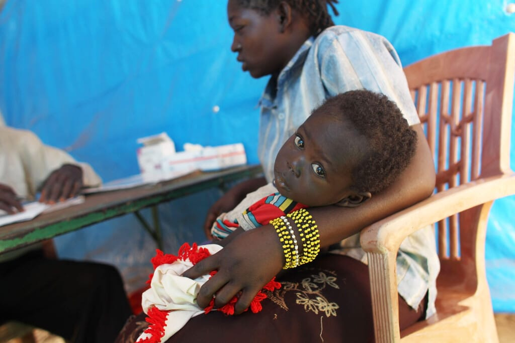 Congolese woman and her child with malaria